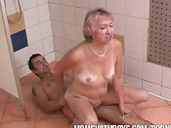 Old Slut and Young Stud In Shower Front
