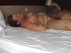 matured couple carrying-on in bed