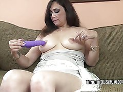 Busty MILF Alesia Pleasure is fucking her purple dildo