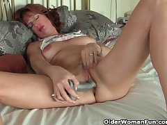 Grown-up redheaded mom masturbates with sex toys