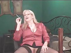 X Adult Blonde shows her overcrowd while smoking