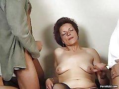 German granny enjoys triple