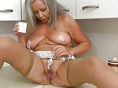 Piping hot grandma in pantry
