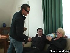 Four guys carrying out drunk granny