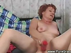 Lusty granny masturbates