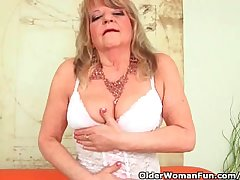 Grandmother With Large Breasts Pushes A Hefty Dildo Into Her Old Pussy
