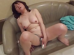 Amatuer Japanese Mature masturbates gear up sucks