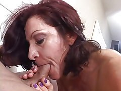 Hot mature brunette masterfully sucks cock after a long time smoking a cigarette