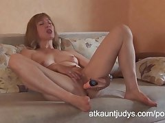 Blonde full-grown amateur Annabella masturbates with a bauble