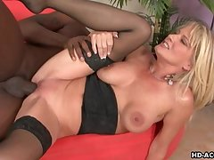 Powered mature babe rides a pitch-black detect