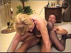 Mature bimbo serves a customer
