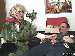 Lonely granny sucks his cock