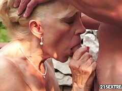 Matured Szuzanne plays with a young cock