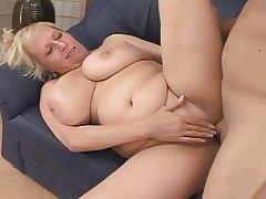 Blonde Mature fucks a guy