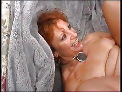 Matured Redhead Enjoys Young Cock