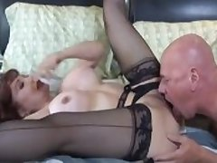 Bald person fucks broad in the beam breasted redhead