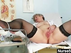 Busty granny hither uniform stretching her aged pussy