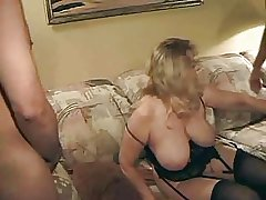Beamy mature masturbates at hand solo with the addition of fucks with twosome boy