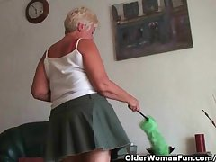 Highly sexed grandma Sandie rubs her pock-marked clit