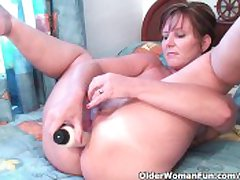 Classy Granny Fucks Her Pussy And Asshole With Dildos Encircling Inn Room