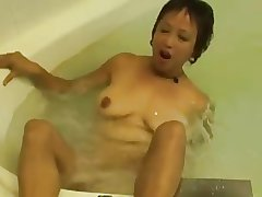 Powered Asian Granny Fucks her Cunt in rub-down the Hot Tub