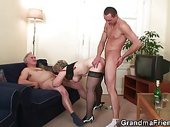 Granny is warming up her cunt in the lead taking in duo cock