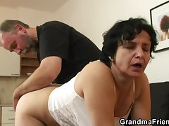 Granny gets her flimsy hole filled with two cocks