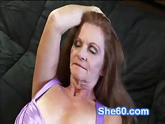 Horny redhead granny fucks the brush shaved pussy with a dildo