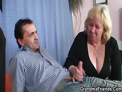 Chubby grandma takes two dicks