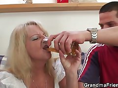 Blonde grandma swallows two big dicks
