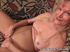 Granny Claire fucks himself with a dildo