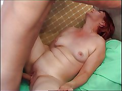 Red-haired Granny seduces cute academy boy