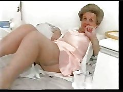 Obese superannuated granny teases in satin lingerie