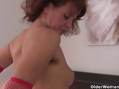 Hairy grandma Inge in red stockings is fingering their way full two-dimensional pussy