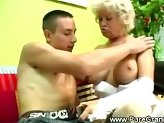 Kinky granny blows younger cock