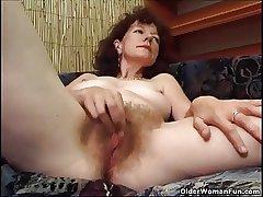 Prudish granny masturbates with a dildo