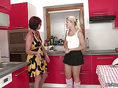 Hot mature together with teen lesbian scene atop the kitchen