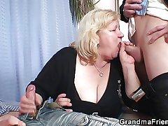 Blonde grandma gets slammed apart from two cocks