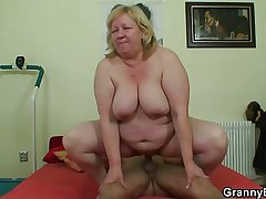 Heavy titted granny tastes yummy cock