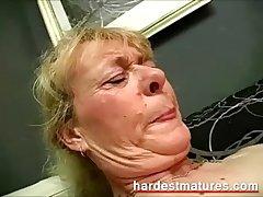 Grandma sucking gumshoe while fingering