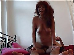 Redhead Mom in stockings blowing cock increased by shagging