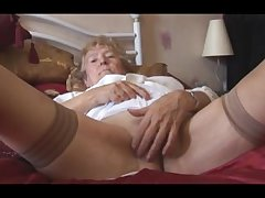 Blonde Granny in stockings posing with the addition of teasing