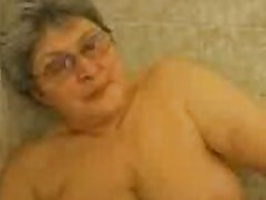 Hot granny having fun surrounding the bath