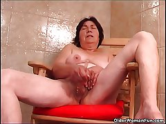 Over 70 granny with queasy pussy fucks a dildo