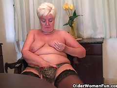 Chunky granny in stockings plays on touching vibrator