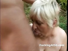 Slutty heavy granny blowjob and fucked wide of the evil spirit outdoors