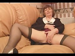 Hairy Granny in stockings plays with undershorts then strips