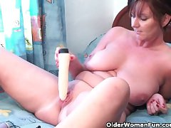 Classy granny plays with say no to dildo collection