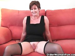 Classy grandma in stockings shows her heavy tits added to pussy
