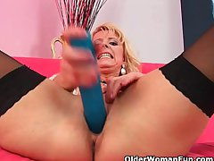 Surrender 50 mommy around stockings probes herself with a obese dildo